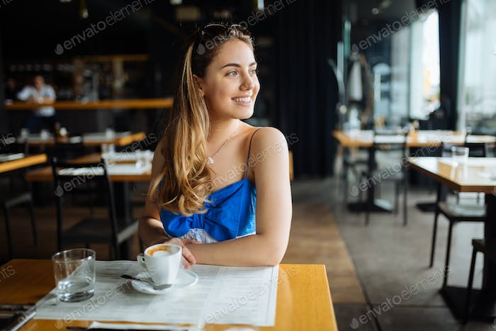 Stunning woman enjoying her coffee