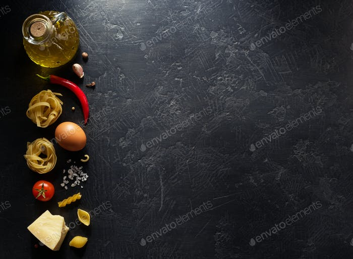 pasta ingredients on black background