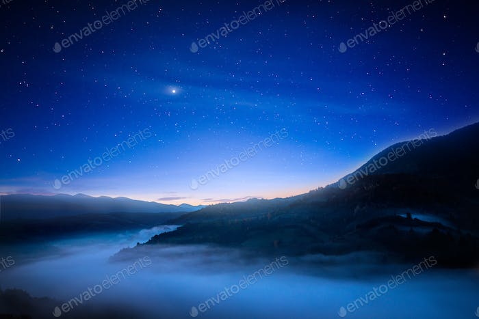 Fantastic night sky over mountains
