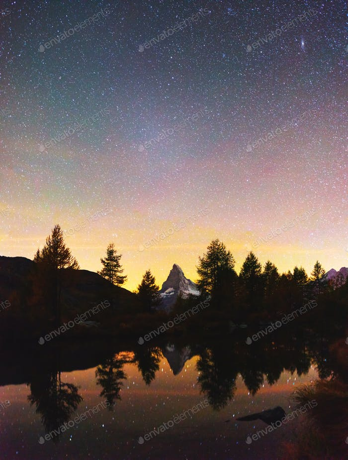 Incredible night view of Grindjisee lake with Matterhorn Cervino peak