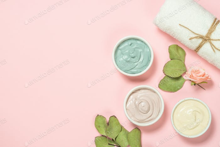 Clay mask on pink bakground, skincare product