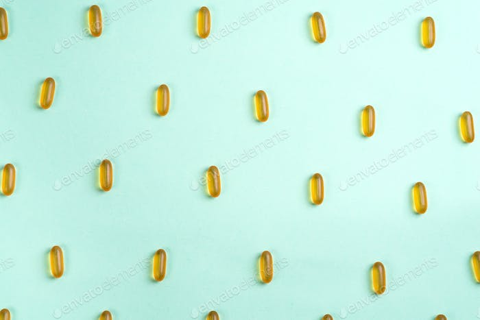 Omega 3 fish oil capsules isolated on a blue background