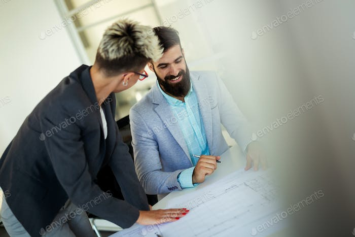 Business people working on laptop computer in office