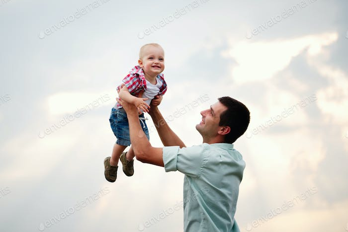 father with son in the wheat field
