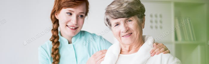 Nurse and elderly patient in hopital