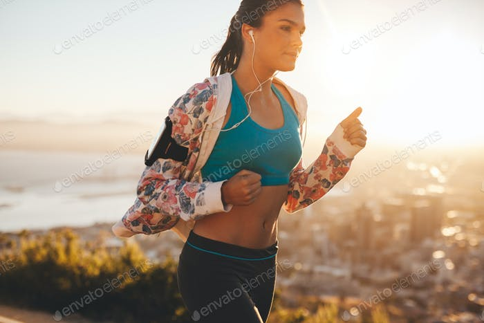 Confident young athlete running outdoors