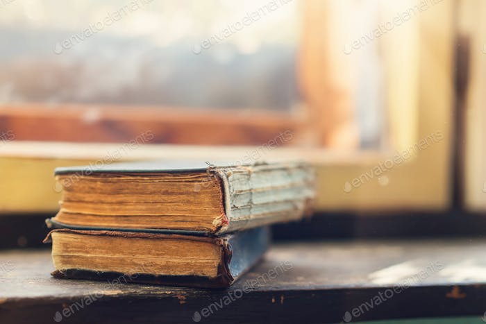 Old books on windowsill
