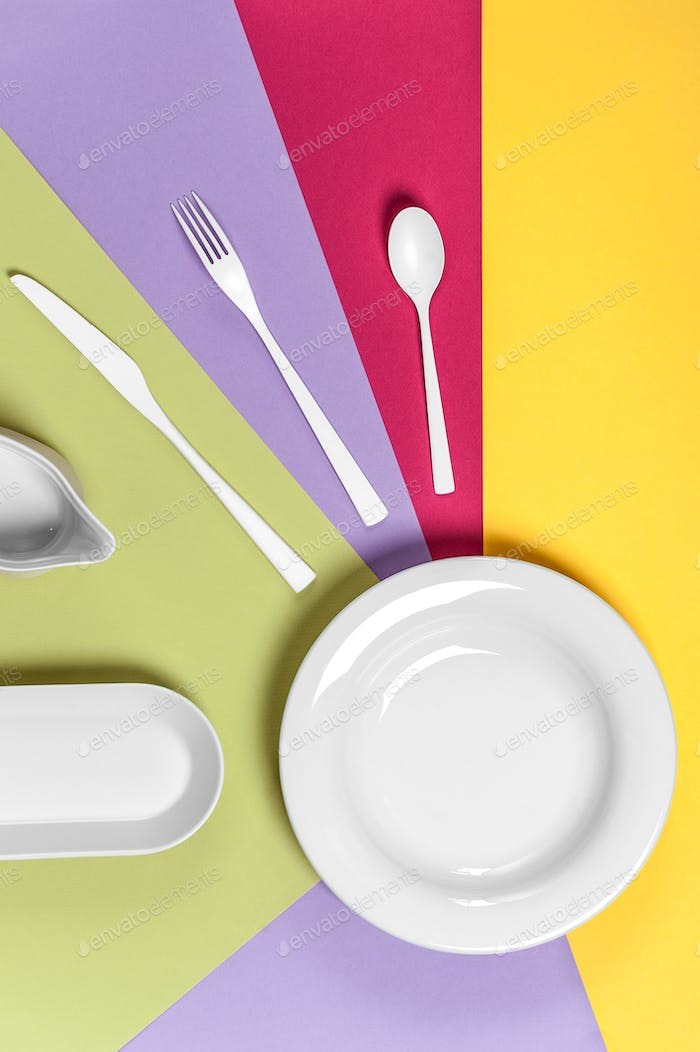 White ceramic ware on a multi-colored background.