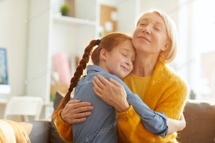 Mother and Daughter Embracing Tenderly