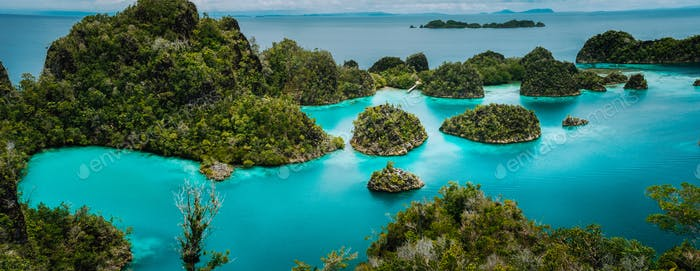 Panoramic view Pianemo Islands, Blue Lagoon with Green lush karst lime stone Rockes, Raja Ampat
