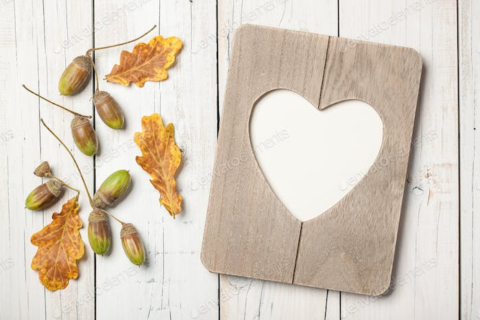 Thanksgiving card with oak leaves, acorns and heart shaped frame