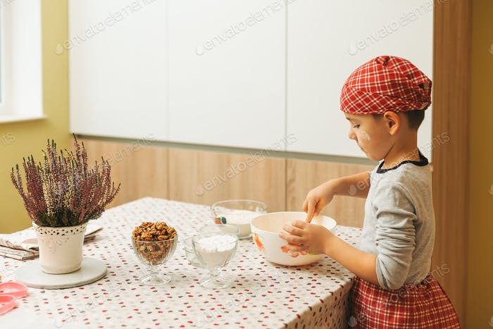 Cute boy cooking sweets