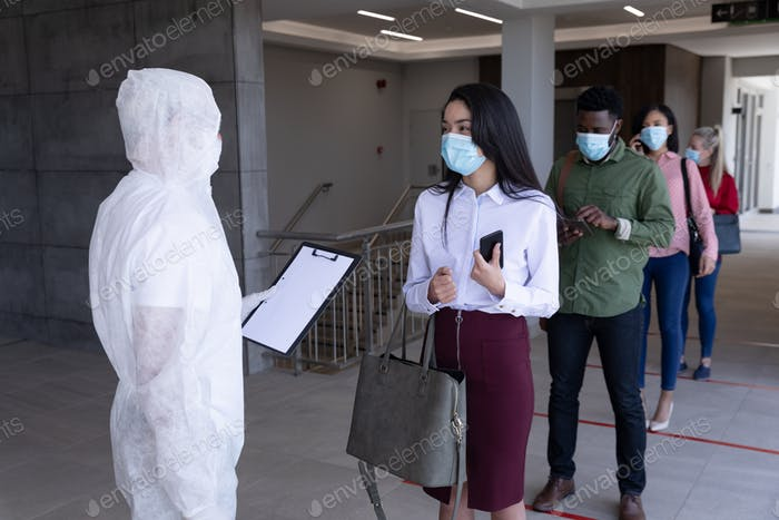 Group of people wearing face masks standing in queue