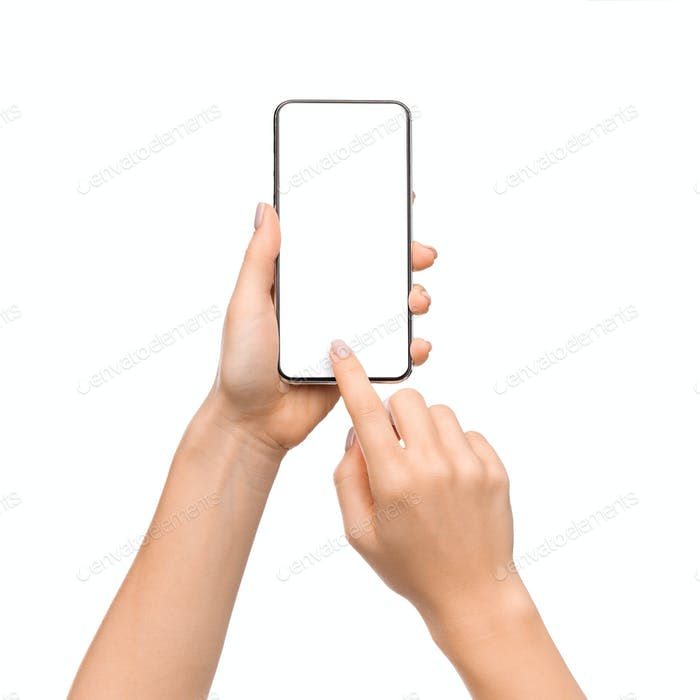 Young woman's hands using smartphone with blank screen