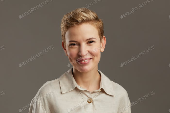 Short Haired Young Woman on Grey