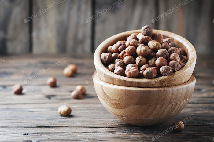 Raw hazelnut on the wooden table