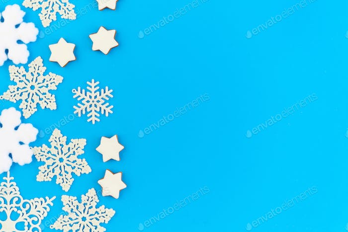 Flat layout of decorative snowflakes and firtrees with copyspace on the right