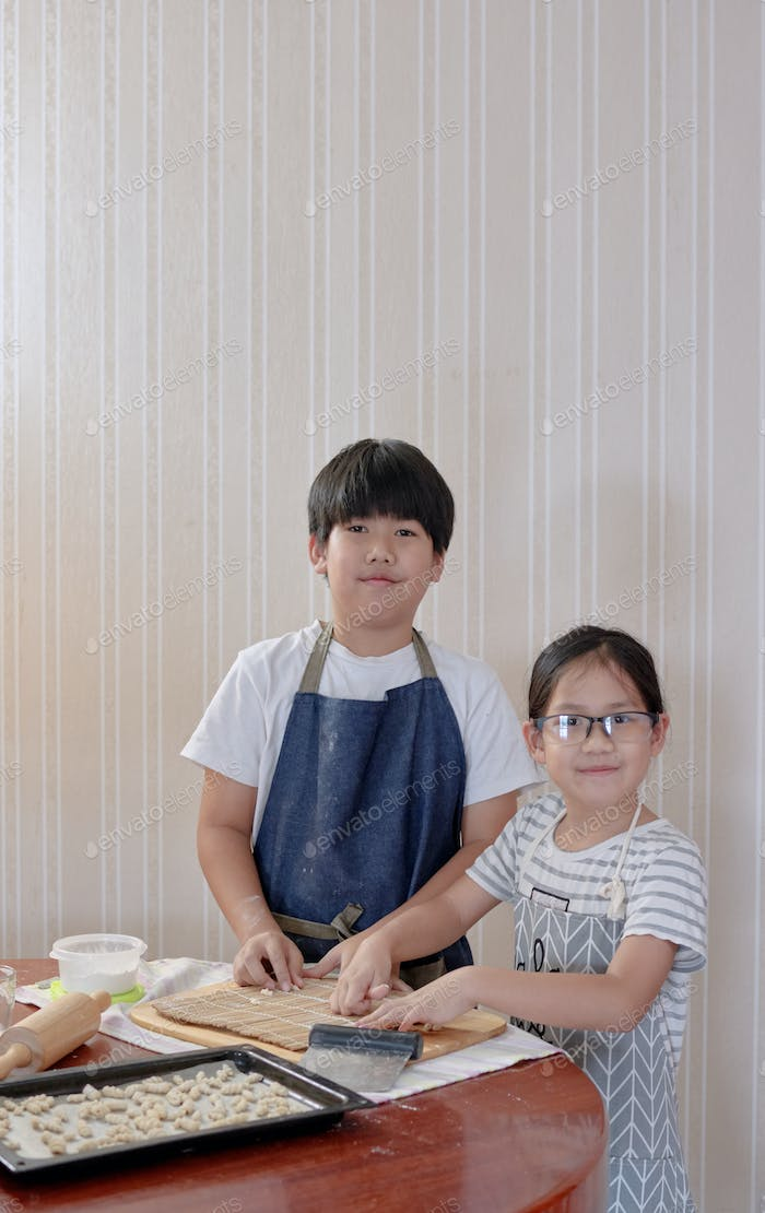 Brother and sister cooking by themself
