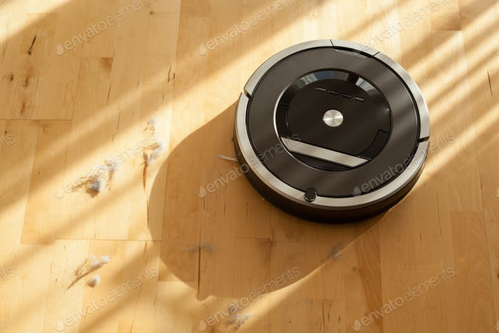 robotic vacuum cleaner on laminate wood floor smart cleaning tec