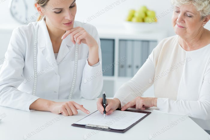 Elderly woman choosing diet plan