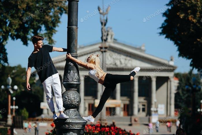 man and woman performing acrobatic tricks
