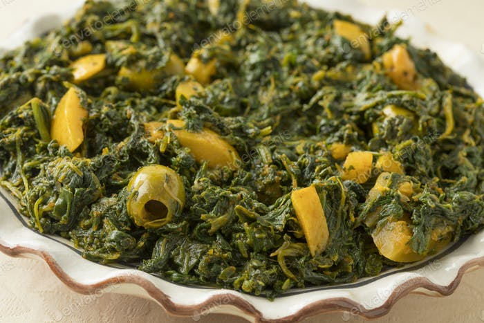 Dish with Moroccan style spinach salad
