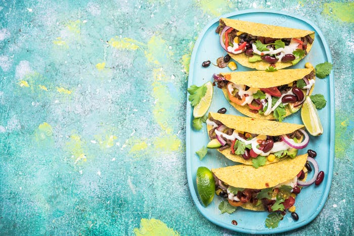 Mexican street food tacos, border background