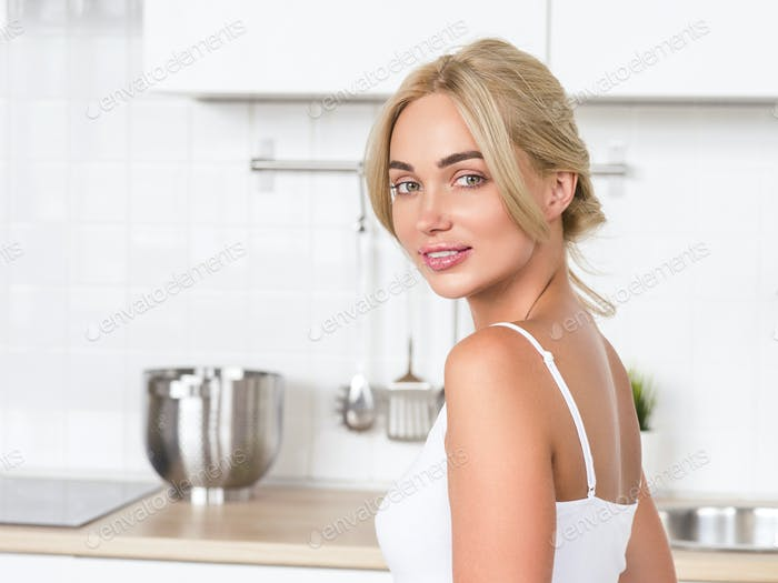 Woman on kitchen morning with fruits. Helthy food and drink diet positive morning female portrait