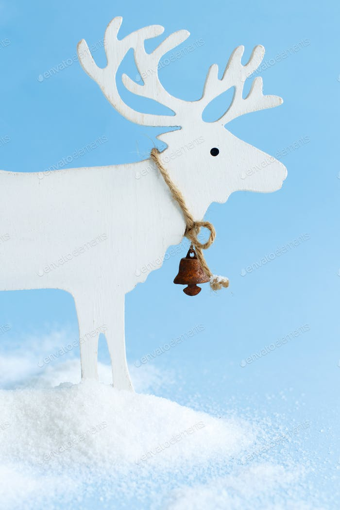 White Wooden Reindeer on a light blue background