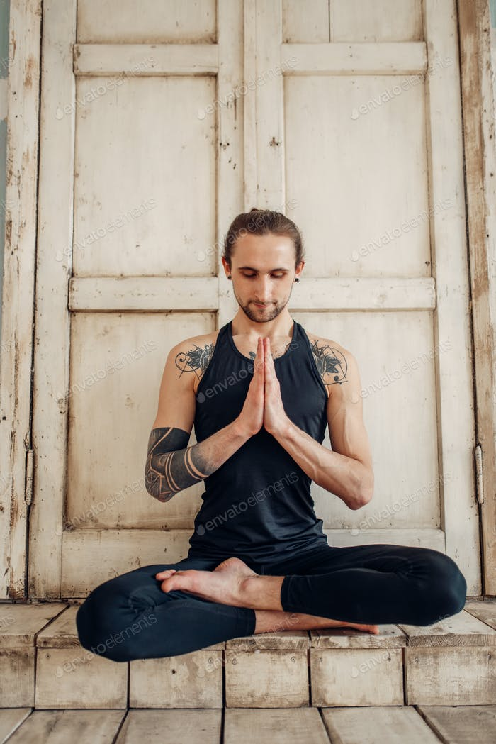 Male yoga, meditation in asana position