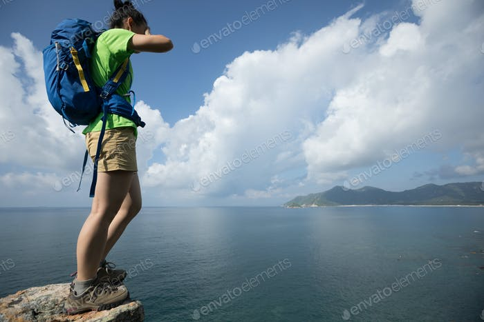 Stand on the cliff edge with eyes covered