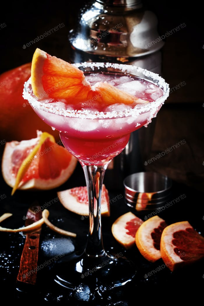 Alcoholic cocktail Greyhound, with vodka, liqueur, grapefruit juice and ice
