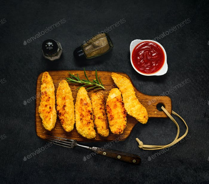 Chicke Fingers with Ketchup and Condiments