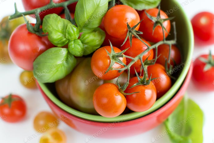 Cherry tomatoes and basil in bowl