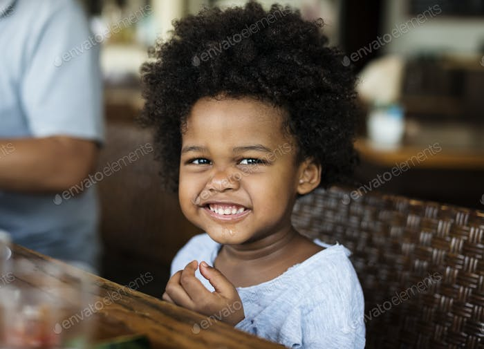 Cute little African boy at a resort