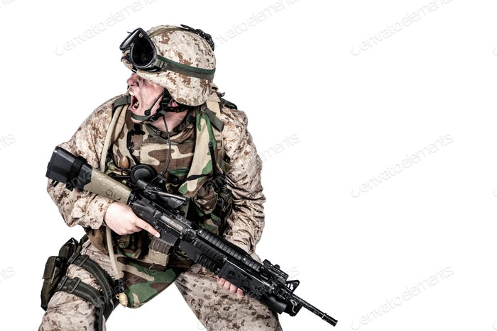 Soldier crouching under fire and screaming orders