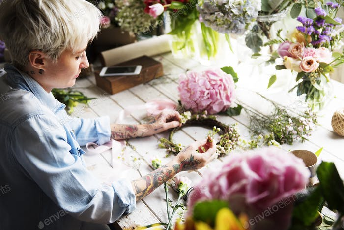 Florist Making Fresh Flowers Crown Arrangement