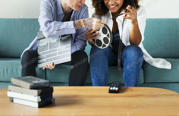 Young women with movie film reel