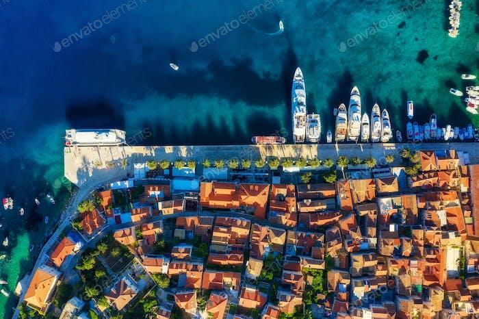 Croatian seascape from air. Yacht and houses. Hvar island