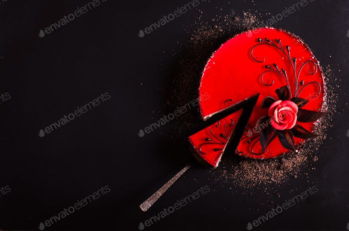 Red Cake with rose on black background. Top view. Valentine's Day. Free space for your text