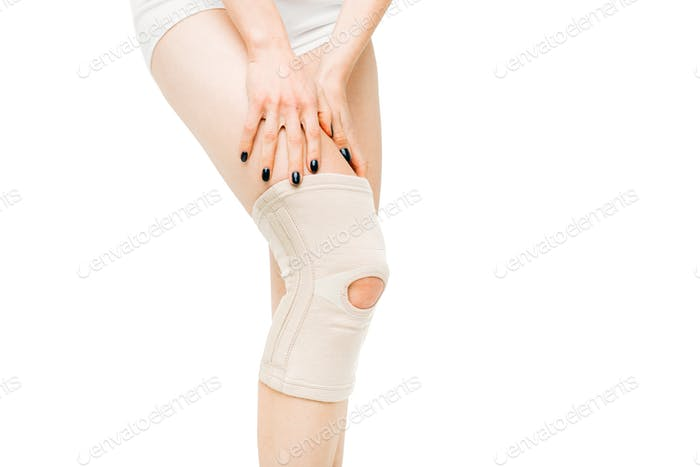 Joint ache, female person with bandage, knee pain