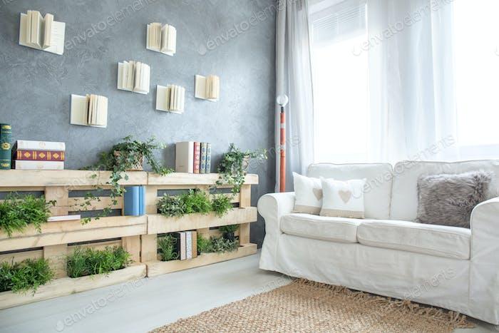 Sofa and bookshelf in room