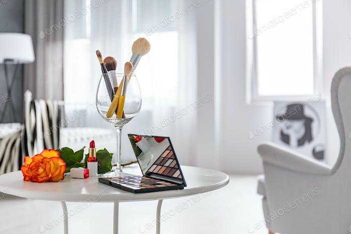 Makeup set on white table