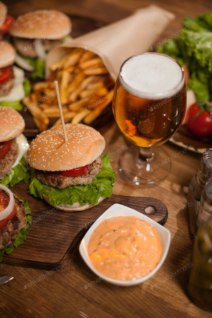 Close up of beef burger and beer on a restaurant table