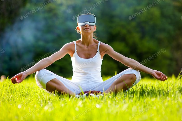 Relax zen young girl using virtual reality headset VR glasses sitting on the street