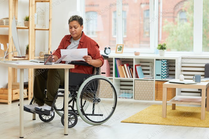 Disabled woman working at her workplace