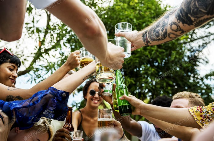 Group of diverse friends celebrating drinking beers together