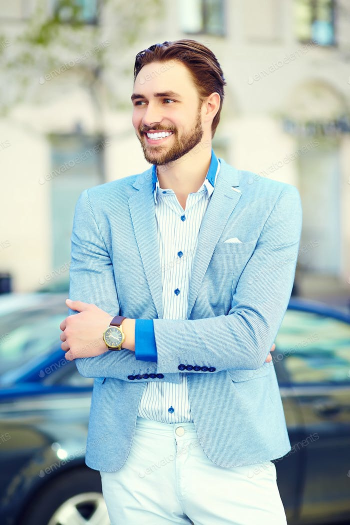 Young stylish confident happy handsome businessman model  in suit cloth lifestyle in the street