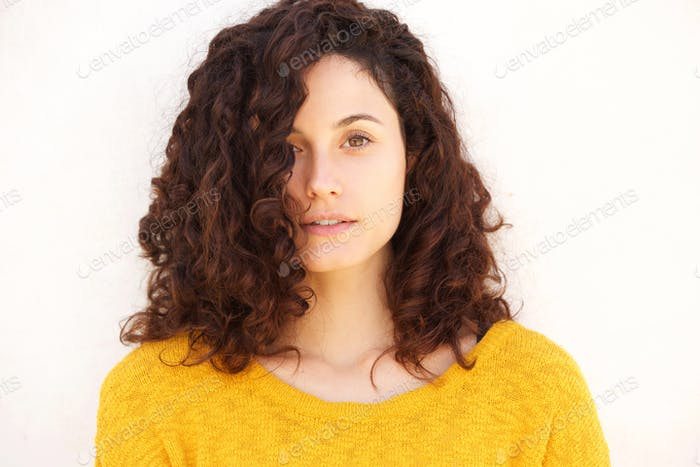Close up attractive  young woman against white background starin