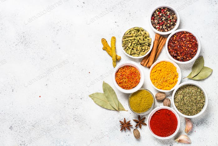 Spices on white stone table